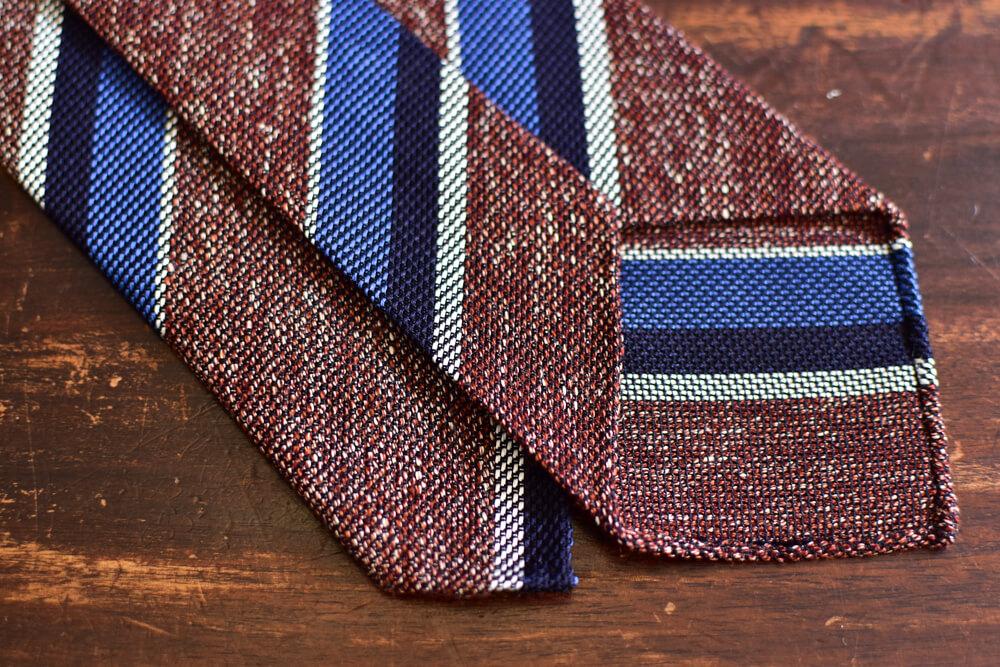 Cravate club non doublée rouge pale et rayures