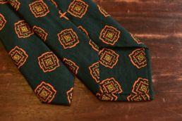 cravate laine et soie vert medaillon orange